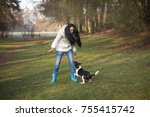 young woman trains the dog in... | Shutterstock . vector #755415742