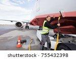 crew member charging airplane... | Shutterstock . vector #755432398