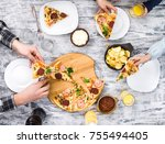 people eating pizza with chips... | Shutterstock . vector #755494405
