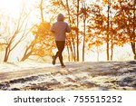 man working out on autumn... | Shutterstock . vector #755515252