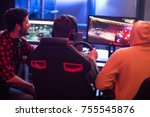 back view of young gamers are... | Shutterstock . vector #755545876