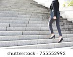 a working woman walking up the... | Shutterstock . vector #755552992