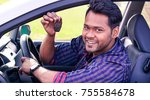 young indian man showing key...   Shutterstock . vector #755584678