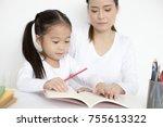 attractive little girl writing... | Shutterstock . vector #755613322