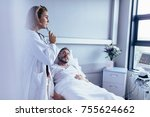 physician in hospital room...   Shutterstock . vector #755624662