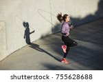 Fitness Woman Skipping With A...