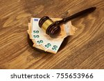 judge gavel and money stack on