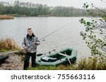 fisherman with a fishing rod... | Shutterstock . vector #755663116