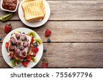 toasts bread with berries on... | Shutterstock . vector #755697796