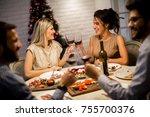 friends celebrating christmas... | Shutterstock . vector #755700376