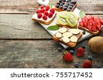 toasts bread with berries on... | Shutterstock . vector #755717452