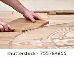 the carpenter installs one of... | Shutterstock . vector #755784655