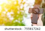 hand holds stone cross on... | Shutterstock . vector #755817262
