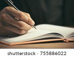 male hand with pen writing in... | Shutterstock . vector #755886022