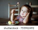 little boy having breakfast at... | Shutterstock . vector #755902492