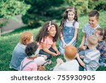 Small photo of Happy children playing in the Park in the summer. Multicultural group. the concept of childhood, friendship and intercultural communication.