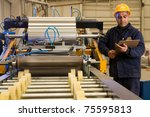 Factory Worker Processing Roll...