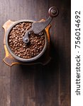 Old Coffee Grinder And Roasted...