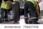 airport worker checking chassis.... | Shutterstock . vector #756027436