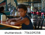 boy siting in cafe. mixed boy  | Shutterstock . vector #756109258