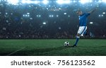 soccer player kicks the ball on ... | Shutterstock . vector #756123562