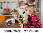 a boy adjusts a green...   Shutterstock . vector #756143386
