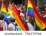 People With Rainbows Flags In...