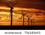 Wind Turbine On Sunset...