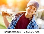 teenage boy with skateboard... | Shutterstock . vector #756199726