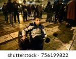 Small photo of Thessaloniki, Greece - November 15, 2017. A refugee boy holds his suitcase, as refugees get ready to march from Thessaloniki city to the Greek - Macedonian border.