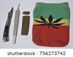 milan   piece of hashish  knife ... | Shutterstock . vector #756273742