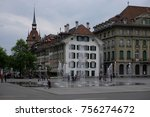 Small photo of Bern, Switzerland - April 21, 2017: Cityscape at Central Square with Fountain in Capital City of Switzerland, View of the Old City of Bern from The Stone Bridge, over Aare river, Switzerland