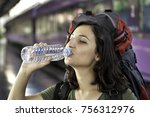 young woman at the train... | Shutterstock . vector #756312976