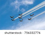 Small photo of EDEN PRAIRIE, MN - JULY 16, 2016: AT6 Texan planes with smoke trails at air show. The AT6 Texan was primarily used as trainer aircraft during and after World War II.