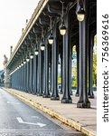 Small photo of Alignment of metal pillars and Art Deco street lights of the Bir-Hakeim bridge in Paris.