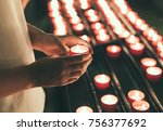 woman holding candle near altar ... | Shutterstock . vector #756377692
