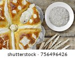 Small photo of Homemade decorated Serbian slava bread on the rustic wooden board.