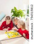 three children playing a board... | Shutterstock . vector #756515812