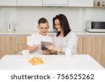 mother and son using digital... | Shutterstock . vector #756525262