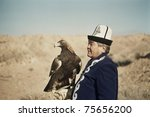 Small photo of OSH, KYRGYZSTAN - NOVEMBER 4: Traditional eagle hunter holds his trained eagle on November 4, 2010 in Osh, Kyrgyzstan. The sport has been vehemently criticised by animal rights protesters.