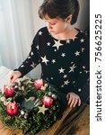 young girl lighting the last...   Shutterstock . vector #756625225