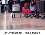 people walking in airport with... | Shutterstock . vector #756650596
