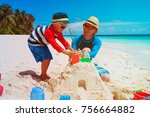 father and son building sand... | Shutterstock . vector #756664882