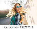 young woman walking in street ... | Shutterstock . vector #756719512