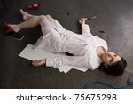 Crime scene. Nurse lying on the floor - stock photo