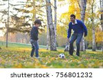 father and son play with ball... | Shutterstock . vector #756801232