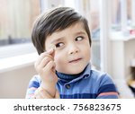 cute little boy holding one... | Shutterstock . vector #756823675