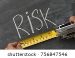 hand measuring word risk | Shutterstock . vector #756847546