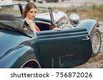 elegant woman in a red dress... | Shutterstock . vector #756872026