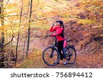 pretty woman on bicycle in the... | Shutterstock . vector #756894412